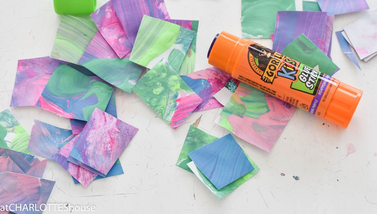 Gorilla Glue stick with colored pieces of paper