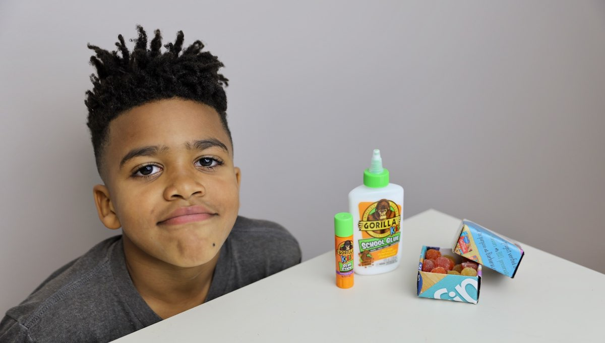 Young boy with Gorilla Kids Glue products and finished snack box