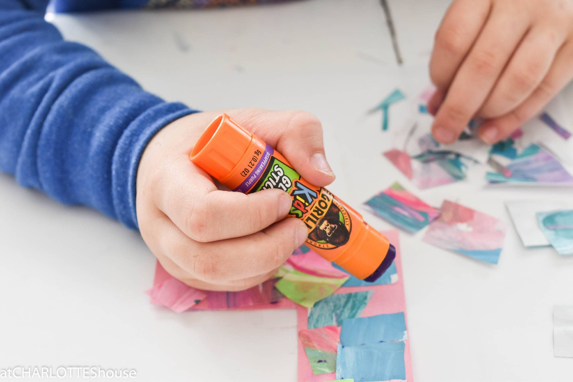 Child's hand using Gorilla Glue Stick
